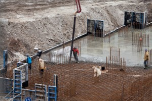Construction of the building. Pouring the concrete foundation slab foundation. The concrete base slab foundation under the building. Stages of construction of the building. Foundation plate and armature.